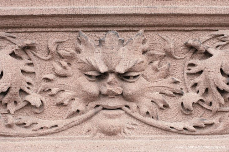 bas relief face with nose broken